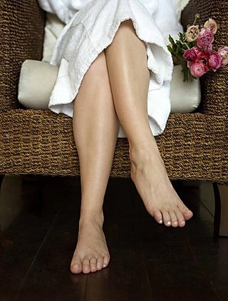 Legs of Woman in Spa Robe